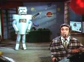 Robot se prikrada Bitiku ispred nezaboravno oslikanog zida jazbine Dr. Satana